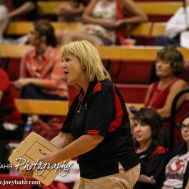 Kingman Lady Eagle Head Coach Kay Stimatze celebrates winning a point during the Kingman Lady Eagles versus Larned Lady Indians volleyball match with Kingman winning 25-21, 24-26, 25-15 at Hoisington Activity Center in Hoisington, Kansas on September 9, 2014. (Photo: Joey Bahr, www.joeybahr.com)