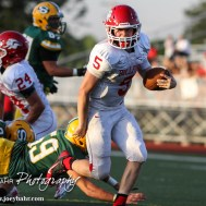 McPherson Bullpup Kyler Kinnamon (#5) carries the ball during the McPherson Bullpups versus Salina South Cougars High School Football gamme with Salina South winning 61 to 32 at Salina Stadium in Salina, Kansas on September 4, 2014. (Photo: Joey Bahr, www.joeybahr.com)