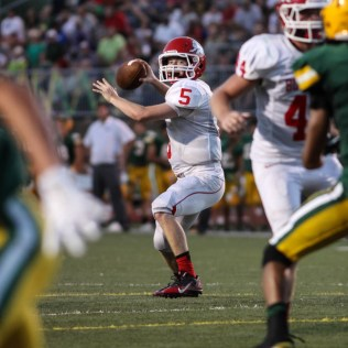 McPherson Bullpup Kyler Kinnamon (#5) passes the ball during the McPherson Bullpups versus Salina South Cougars High School Football gamme with Salina South winning 61 to 32 at Salina Stadium in Salina, Kansas on September 4, 2014. (Photo: Joey Bahr, www.joeybahr.com)