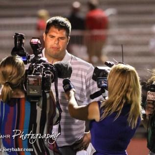 Members of the Press interview Salina South Cougar Head Coach Sam Sellers following the McPherson Bullpups versus Salina South Cougars High School Football gamme with Salina South winning 61 to 32 at Salina Stadium in Salina, Kansas on September 4, 2014. (Photo: Joey Bahr, www.joeybahr.com)