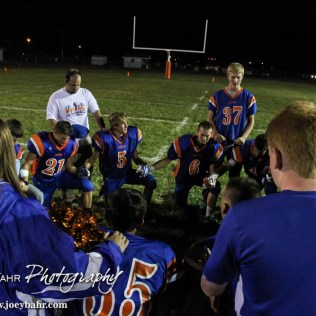 The Otis-Bison Cougars huddle up to pray after the Otis-Bison versus Kinsley High School 8-Man Football Game with Otis-Bison winning 104 to 70 which set a new state record for combined points in a game at Cougar Field at Otis-Bison High School in Otis, Kansas on September 26, 2014. (Photo: Joey Bahr, www.joeybahr.com)