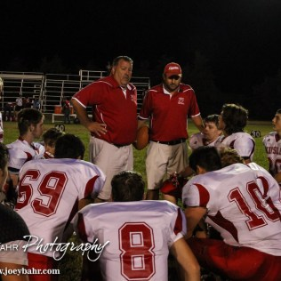 Kinsley Coyote Head Coach Jeff Chambers addresses his players follwoing the Otis-Bison versus Kinsley High School 8-Man Football Game with Otis-Bison winning 104 to 70 which set a new state record for combined points in a game at Cougar Field at Otis-Bison High School in Otis, Kansas on September 26, 2014. (Photo: Joey Bahr, www.joeybahr.com)