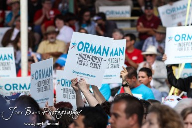 Supporters of Greg Orman hold up signs during the WIBW 2014 Kansas State Fair Senate debate between United States Senator Pat Roberts and Greg Orman at Bretz-Young Injury Lawyers Arena on the Kansas State Fairgrounds in Hutchinson, Kansas on September 6, 2014. (Photo: Joey Bahr, www.joeybahr.com)