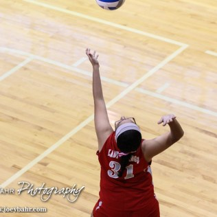 Macksville Lady Mustang Lyset Ibarra (#31) serves the ball during the 2014 Central Prairie League Volleyball Tournament at Hoisington Activity Center in Hoisington, Kansas on October 18, 2014. (Photo: Joey Bahr, www.joeybahr.com)