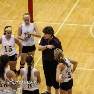 Victoria Lady Knight Head Coach Debbie Bottorf talks to her players in a timeout during the 2014 Central Prairie League Volleyball Tournament at Hoisington Activity Center in Hoisington, Kansas on October 18, 2014. (Photo: Joey Bahr, www.joeybahr.com)