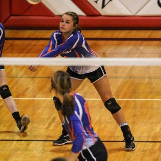 Otis-Bison Lady Cougar Lacey Mitchel (#1) digs a serve during the 2014 Central Prairie League Volleyball Tournament at Hoisington Activity Center in Hoisington, Kansas on October 18, 2014. (Photo: Joey Bahr, www.joeybahr.com)