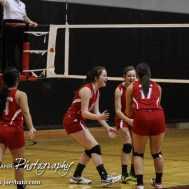 The Kinsley Lady Coyotes celebrate scoring a point during the 2014 Central Prairie League Volleyball Tournament at Hoisington Activity Center in Hoisington, Kansas on October 18, 2014. (Photo: Joey Bahr, www.joeybahr.com)