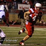 Hoisington Cardinal KC Stephens (#43) rushes with the ball during the Hoisington Cardinals versus Lyons Lions High School Football game with Hoisington winning 54 to 13 at Elton Brown Field at Hoisington High School in Hoisington, Kansas on October 30, 2014. (Photo: Joey Bahr, www.joeybahr.com)
