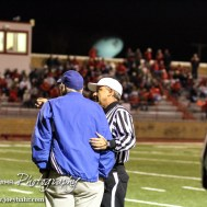 The referee talks to Lyons Lion Head Coach James Johnston after a few Personal Fouls had been called during the Hoisington Cardinals versus Lyons Lions High School Football game with Hoisington winning 54 to 13 at Elton Brown Field at Hoisington High School in Hoisington, Kansas on October 30, 2014. (Photo: Joey Bahr, www.joeybahr.com)