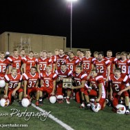 The Hoisington Cardinals pose for a picture with the District 15 Champions Trophy following the Hoisington Cardinals versus Lyons Lions High School Football game with Hoisington winning 54 to 13 at Elton Brown Field at Hoisington High School in Hoisington, Kansas on October 30, 2014. (Photo: Joey Bahr, www.joeybahr.com)