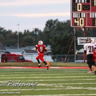 Hoisington Cardinal Brandon Ball (#9) dashes to the end zone during the Hoisington High School versus Smoky Valley football game with Hoisington winning 33 to 12 at Eldon Brown Field in Hoisington, Kansas on October 10, 2014. (Photo: Joey Bahr, www.joeybahr.com)