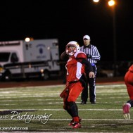 Hoisington Cardinal Tyler Specht (#1) prepares to throw a pass during the Hoisington High School versus Smoky Valley football game with Hoisington winning 33 to 12 at Eldon Brown Field in Hoisington, Kansas on October 10, 2014. (Photo: Joey Bahr, www.joeybahr.com)