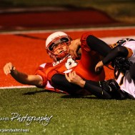 Hoisington Cardinal Steffan Dolechek (#4) slides in near the end zone after catching a pass during the Hoisington High School versus Smoky Valley football game with Hoisington winning 33 to 12 at Eldon Brown Field in Hoisington, Kansas on October 10, 2014. (Photo: Joey Bahr, www.joeybahr.com)