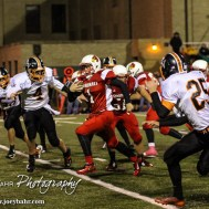 Hoisington Cardinal Tyler Specht (#1) breaks through a hole during the Hoisington High School versus Smoky Valley football game with Hoisington winning 33 to 12 at Eldon Brown Field in Hoisington, Kansas on October 10, 2014. (Photo: Joey Bahr, www.joeybahr.com)