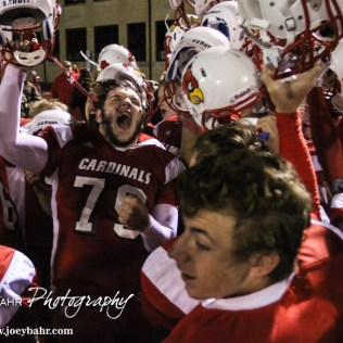 Hoisington Cardinal Seth Owen (#79) leads his team in a chant after the Hoisington High School versus Smoky Valley football game with Hoisington winning 33 to 12 at Eldon Brown Field in Hoisington, Kansas on October 10, 2014. (Photo: Joey Bahr, www.joeybahr.com)
