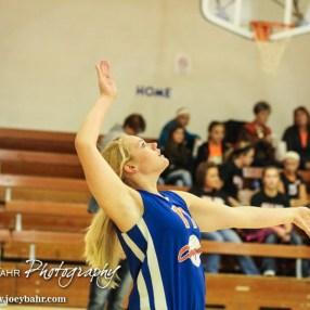 Otis-Bison Lady Cougar Haley Vondracek (#17) prepares to serve the ball during the Otis-Bison/LaCrosse Volleyball Tournament Pool Play at Otis-Bison High School in Otis, Kansas on September 13, 2014. (Photo: Joey Bahr, www.joeybahr.com)