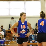 Otis-Bison Lady Cougar Demi Bartonek (#19) waits for the ball to be served during the Otis-Bison/LaCrosse Volleyball Tournament Pool Play at Otis-Bison High School in Otis, Kansas on September 13, 2014. (Photo: Joey Bahr, www.joeybahr.com)