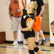 Ellis Lady Railer Sarah Mick (#4) serves the ball during the Otis-Bison/LaCrosse Volleyball Tournament Pool Play at Otis-Bison High School in Otis, Kansas on September 13, 2014. (Photo: Joey Bahr, www.joeybahr.com)