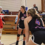 Otis-Bison Lady Cougar Demi Bartonek (#19) waits for the ball to be served during the Otis-Bison High School versus Macksville volleyball game at Otis-Bison High School in Otis, Kansas on October 7, 2014. (Photo: Joey Bahr, www.joeybahr.com)