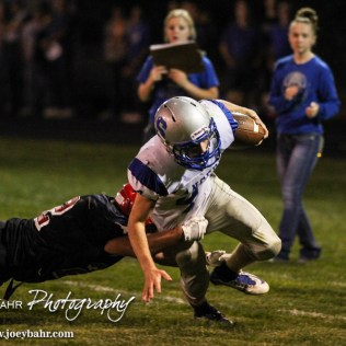 Spearville Lancer Luke Heskamp (#4) dives for extra yards during the Spearville at Hodgeman County High School Football Game with Spearville winning 50 to 28 at Sayler Field in Jetmore, Kansas on October 24, 2014. (Photo: Joey Bahr, www.joeybahr.com)