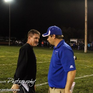 Hodgeman County Longhorn Head Coach Matt Housman and Spearville Lancer Head Coach Matt Fowler talk after the Spearville at Hodgeman County High School Football Game with Spearville winning 50 to 28 at Sayler Field in Jetmore, Kansas on October 24, 2014. (Photo: Joey Bahr, www.joeybahr.com)