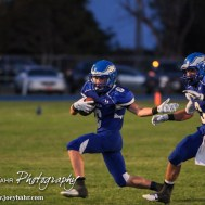 Ness City Eagle Jacob Hoss (#6) carries the ball as Pedro Flores (#3) blocks during the Spearville versus Ness City High School 8-Man Football Game with Spearville winning 50 to 38 at Ness City High School in Ness City, Kansas on October 3, 2014. (Photo: Joey Bahr, www.joeybahr.com)