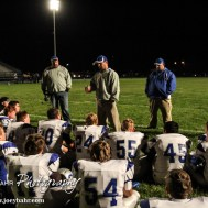 Spearville Lancer Head Coach Matt Fowler talks to his players after the Spearville versus Ness City High School 8-Man Football Game with Spearville winning 50 to 38 at Ness City High School in Ness City, Kansas on October 3, 2014. (Photo: Joey Bahr, www.joeybahr.com)