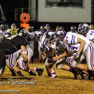 The Meade Buffalo Offensive Line fires off the ball during the KSHSAA Class 2-1A Regional Football game with Meade at LaCrosse with LaCrosse winning 34 to 0 at Bill Schoendaller Athletic Field in LaCrosse, Kansas on November 7, 2014. (Photo: Joey Bahr, www.joeybahr.com)