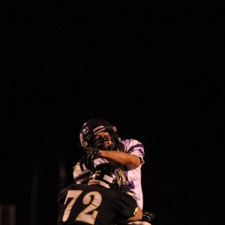 LaCrosse Leopard Justin Bond (#72) hits Meade Buffalo Ryan Friesen (#42) as he throws a pass during the KSHSAA Class 2-1A Regional Football game with Meade at LaCrosse with LaCrosse winning 34 to 0 at Bill Schoendaller Athletic Field in LaCrosse, Kansas on November 7, 2014. (Photo: Joey Bahr, www.joeybahr.com)