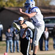 Spearville Lancer Nathan Stein (#8) punts the ball during the KSHSAA Eight Man Division I Regional Football game between Spearville and Central Plains with Central Plains winning 42 to 40 at Central Plains High School in Claflin, Kansas on November 8, 2014. (Photo: Joey Bahr, www.joeybahr.com)