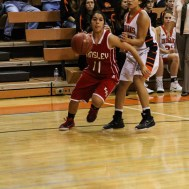 Kinsley Lady Coyote Gisel Holguin (#11) dribbles around Larned Lady Indian Shaylene Shepherd (#3) during Seventh Annual Keady Basketball Classic First Round game between the Kinsley Lady Coyotes and the Larned Lady Indians with Kinsley winning 47 to 31 at Larned Middle School in Larned, Kansas on December 8, 2014. (Photo: Joey Bahr, www.joeybahr.com)