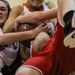 Larned Lady Indian Allyson Aldrich (#2) fights for a loose ball during Seventh Annual Keady Basketball Classic First Round game between the Kinsley Lady Coyotes and the Larned Lady Indians with Kinsley winning 47 to 31 at Larned Middle School in Larned, Kansas on December 8, 2014. (Photo: Joey Bahr, www.joeybahr.com)