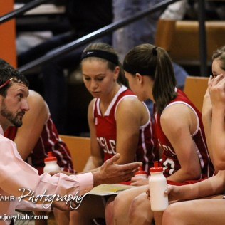 Kinsley Lady Coyote Assistant Coach Sean Wilkinson talks to his players during Seventh Annual Keady Basketball Classic First Round game between the Kinsley Lady Coyotes and the Larned Lady Indians with Kinsley winning 47 to 31 at Larned Middle School in Larned, Kansas on December 8, 2014. (Photo: Joey Bahr, www.joeybahr.com)
