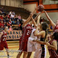 Players extend their arms to try and pull in a loose ball during Seventh Annual Keady Basketball Classic First Round game between the Kinsley Lady Coyotes and the Larned Lady Indians with Kinsley winning 47 to 31 at Larned Middle School in Larned, Kansas on December 8, 2014. (Photo: Joey Bahr, www.joeybahr.com)