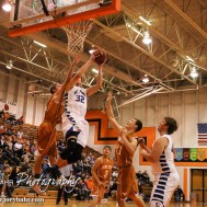St. John Tiger Dean Wade (#32) goes for a dunk during the Seventh Annual Keady Basketball Classic First Round game between the St. John Tigers and the Kiowa County Mavericks with St. John winning 74 to 30 at Larned Middle School in Larned, Kansas on December 9, 2014. (Photo: Joey Bahr, www.joeybahr.com)