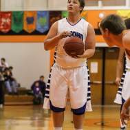 St. John Tiger Jacob Milton (#44) prepares to shoot a free throw attempt during the Seventh Annual Keady Basketball Classic First Round game between the St. John Tigers and the Kiowa County Mavericks with St. John winning 74 to 30 at Larned Middle School in Larned, Kansas on December 9, 2014. (Photo: Joey Bahr, www.joeybahr.com)