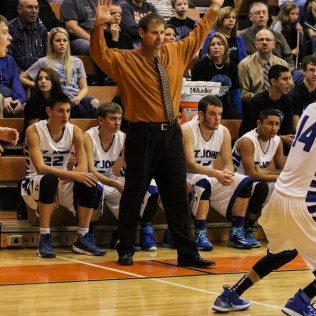 St. John Tiger Head Coach Clint Kinnamon signals to his players during the Seventh Annual Keady Basketball Classic First Round game between the St. John Tigers and the Kiowa County Mavericks with St. John winning 74 to 30 at Larned Middle School in Larned, Kansas on December 9, 2014. (Photo: Joey Bahr, www.joeybahr.com)