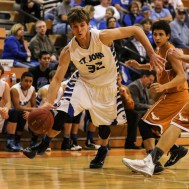 St. John Tiger Dean Wade (#32) drives with the ball during the Seventh Annual Keady Basketball Classic First Round game between the St. John Tigers and the Kiowa County Mavericks with St. John winning 74 to 30 at Larned Middle School in Larned, Kansas on December 9, 2014. (Photo: Joey Bahr, www.joeybahr.com)