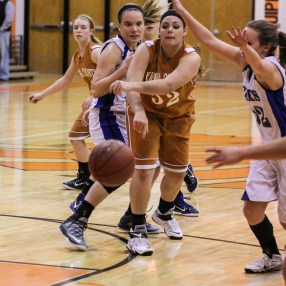 Kiowa County Lady Maverick McKenzie Heft (#52) passes the ball to a teammate during the Seventh Annual Keady Basketball Classic First Round game between the St. John Lady Tigers and the Kiowa County Lady Mavericks with St. John winning 47 to 31 at Larned Middle School in Larned, Kansas on December 9, 2014. (Photo: Joey Bahr, www.joeybahr.com)