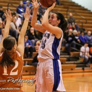 St. John Lady Tiger Teresa Christie (#33) shoots a jump shot during the Seventh Annual Keady Basketball Classic First Round game between the St. John Lady Tigers and the Kiowa County Lady Mavericks with St. John winning 47 to 31 at Larned Middle School in Larned, Kansas on December 9, 2014. (Photo: Joey Bahr, www.joeybahr.com)