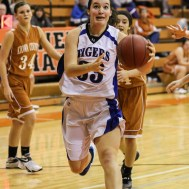 St. John Lady Tiger Teresa Christie (#33) drives into the lane during the Seventh Annual Keady Basketball Classic First Round game between the St. John Lady Tigers and the Kiowa County Lady Mavericks with St. John winning 47 to 31 at Larned Middle School in Larned, Kansas on December 9, 2014. (Photo: Joey Bahr, www.joeybahr.com)