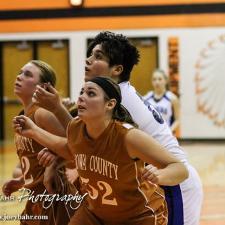 Kiowa County Lady Maverick McKenzie Heft (#52) blocks out St. John Lady Tiger Bella Haskins (#52) during the Seventh Annual Keady Basketball Classic First Round game between the St. John Lady Tigers and the Kiowa County Lady Mavericks with St. John winning 47 to 31 at Larned Middle School in Larned, Kansas on December 9, 2014. (Photo: Joey Bahr, www.joeybahr.com)
