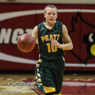 Pratt Greenback Noah Myers (#10) dribbles the ball down the court during the Pratt Greenbacks at Hoisington Cardinals Boys Basketball game with Pratt winning 66 to 34 at Hoisington Activity Center in Hoisington, Kansas on January 6, 2015. (Photo: Joey Bahr, www.joeybahr.com)