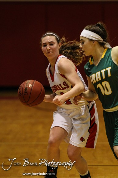 Hoisington Lady Cardinal Karisa Schremmer (#4) dribbles the ball down the court as Pratt Lady Greenback Breann Becker (#10) pressures her during the Pratt Lady Greenbacks at Hoisington Lady Cardinals Girls Basketball game with Pratt winning 34 to 23 at Hoisington Activity Center in Hoisington, Kansas on January 6, 2015. (Photo: Joey Bahr, www.joeybahr.com)