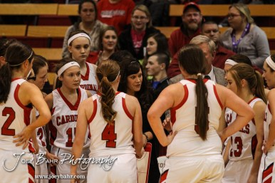 Hoisington Lady Cardinal Head Coach Mandy Mason talks to her players in a timeout during the Pratt Lady Greenbacks at Hoisington Lady Cardinals Girls Basketball game with Pratt winning 34 to 23 at Hoisington Activity Center in Hoisington, Kansas on January 6, 2015. (Photo: Joey Bahr, www.joeybahr.com)