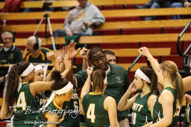 Pratt Lady Greenback Head Coach Emmanuel Adigun address his players during a timeout during the Pratt Lady Greenbacks at Hoisington Lady Cardinals Girls Basketball game with Pratt winning 34 to 23 at Hoisington Activity Center in Hoisington, Kansas on January 6, 2015. (Photo: Joey Bahr, www.joeybahr.com)