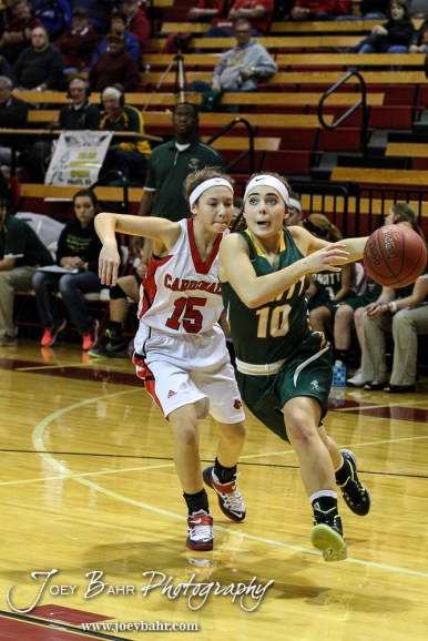 Pratt Lady Greenback Breann Becker (#10) drives to the basket during the Pratt Lady Greenbacks at Hoisington Lady Cardinals Girls Basketball game with Pratt winning 34 to 23 at Hoisington Activity Center in Hoisington, Kansas on January 6, 2015. (Photo: Joey Bahr, www.joeybahr.com)