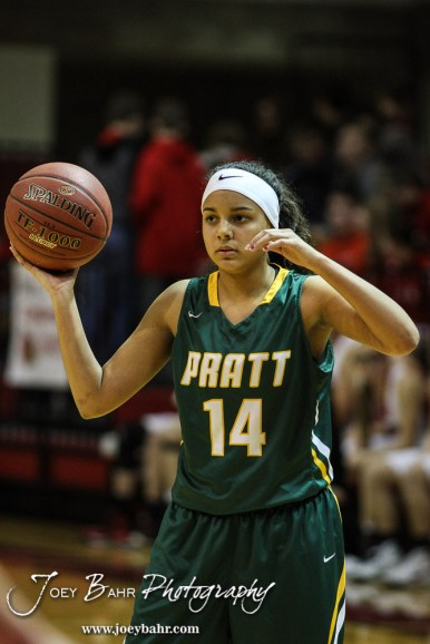 Pratt Lady Greenback Stonie Flemming (#14) looks for a teammate to pass the ball to during the Pratt Lady Greenbacks at Hoisington Lady Cardinals Girls Basketball game with Pratt winning 34 to 23 at Hoisington Activity Center in Hoisington, Kansas on January 6, 2015. (Photo: Joey Bahr, www.joeybahr.com)