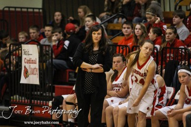 Hoisington Lady Cardinal Head Coach Mandy Mason watches a play develop during the Pratt Lady Greenbacks at Hoisington Lady Cardinals Girls Basketball game with Pratt winning 34 to 23 at Hoisington Activity Center in Hoisington, Kansas on January 6, 2015. (Photo: Joey Bahr, www.joeybahr.com)