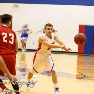 Ellinwood Eagle Gavin Vink (#35) passes the ball to a teammate during the 2A Sub-State First Round Game with the Ellinwood Eagles vs the Ell-Saline Cardinals with Ellinwood winning 59 to 37 at Ellinwood High School in Ellinwood, Kansas on March 2, 2015. (Photo: Joey Bahr, www.joeybahr.com)